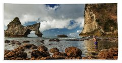 Hand Towel featuring the photograph catching fish in Atuh beach by Pradeep Raja Prints