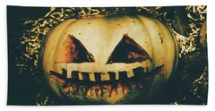 Closeup Of Halloween Pumpkin With Scary Face Bath Towel