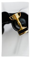 Closeup Of Small Trophy And Binoculars On White Background Bath Towel