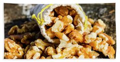 Closeup Of Walnuts Spilling From Small Bag Bath Towel