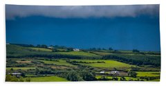 Hand Towel featuring the photograph Clouds Over Shimmering Green Irish Countryside by James Truett