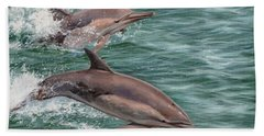 Common Dolphins Hand Towel by David Stribbling