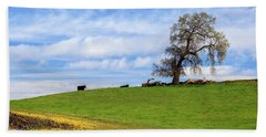 Cows On A Spring Hill Hand Towel by James Eddy