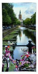 Hand Towel featuring the photograph Canal And Decorated Bike In The Hague by RicardMN Photography