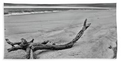 Bath Towel featuring the photograph Driftwood On The Beach In Black And White by Paul Ward