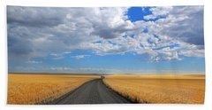 Driving Through The Wheat Fields Bath Towel by Lynn Hopwood