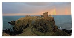Dunnottar Castle Sunset Rainbow Bath Towel by Grant Glendinning