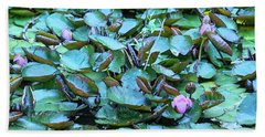 Hand Towel featuring the photograph Painted Water Lilies by Theresa Tahara