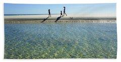 Exploring A Tidal Beach Lagoon Hand Towel