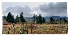Field, Clouds, Distant Foggy Hills Bath Towel