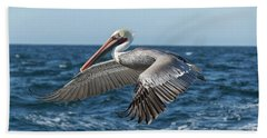 Bath Towel featuring the photograph Flying Brown Pelican by Robert Bales