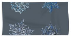 Four Snowflakes On Black Background Hand Towel