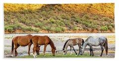 Four Wild Horses Grazing Along Arizona River Hand Towel