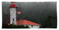 Friendly Cove Lighthouse And Flag Bath Towel