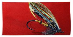 Fully Dressed Salmon Fly On Red Bath Towel by Serge Averbukh