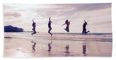 Girls Jumping On Lofoten Beach Bath Towel by Tamara Sushko