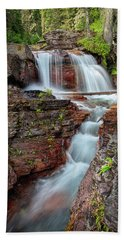 Glacier National Park Waterfall 2 Bath Towel by Andres Leon