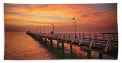 Golden Red Skies Over The Pier Bath Towel