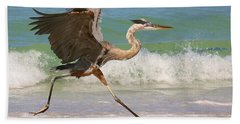 Great Blue Heron Running In The Surf Hand Towel by Myrna Bradshaw