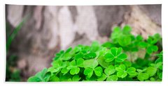 Green Clover And Grey Tree Hand Towel by John Williams