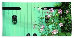 Green Gate With Flowers Hand Towel by Stephanie Moore