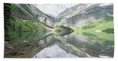 Grinnell Lake Mirrored Hand Towel by Alpha Wanderlust