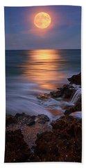Harvest Moon Rising Over Beach Rocks On Hutchinson Island Florida During Twilight. Bath Towel by Justin Kelefas
