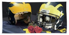 Helmets Of Different Eras With Jersey And Roses Hand Towel