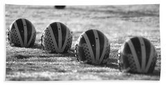 Helmets On Dew-covered Field At Dawn Black And White Hand Towel