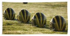 Helmets On Dew-covered Field At Dawn Hand Towel