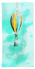 Hot Air Balloon Pendant Over Cloudy Background Bath Towel