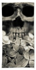 Bath Towel featuring the photograph Human Skull Among Flowers by Edward Fielding