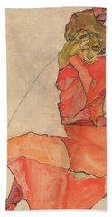 Kneeling Female In Orange-red Dress Bath Towel