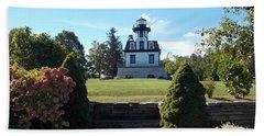 Land Locked Lighthouse Bath Towel by Catherine Gagne