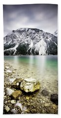 Landscape Of Plansee Lake And Alps Mountains During Winter, Snowy View, Tyrol, Austria. Bath Towel
