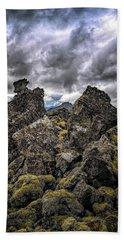 Lava Rock And Clouds Bath Towel