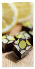 Lemon Chocolate Hand Towel by Sabine Edrissi