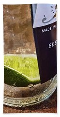 Lime Slice In Cervesa Bottle Bath Towel by Greg Jackson