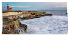 Long Exposure Of Waves Against The Cliff With Lighthouse In Shot Hand Towel