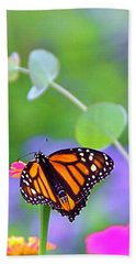 Hand Towel featuring the photograph Magical Monarch by Byron Varvarigos