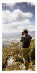 Male Tourist Taking Photo On Mountain Top Bath Towel