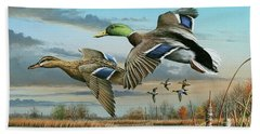 Mallards In Flight Bath Towel by Mike Brown