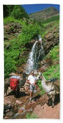 Man Posing With Two Llamas Mountain Waterfall Hand Towel by Jerry Voss