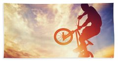 Man Riding A Bmx Bike Performing A Trick Against Sunset Sky Bath Towel