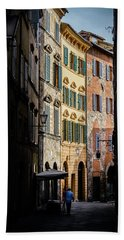 Man Walking Alone In Small Street In Siena, Tuscany, Italy Hand Towel