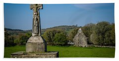 Hand Towel featuring the photograph Medieval High Cross In Irish Pasture by James Truett