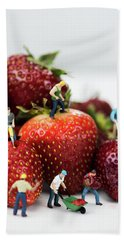 Miniature Construction Workers On Strawberries Hand Towel