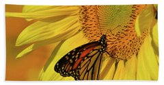 Monarch On Sunflower Bath Towel by Ann Bridges