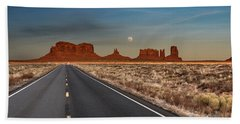 Bath Towel featuring the photograph Moonrise Over Monument Valley by Lou Novick