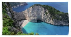 Navagio Beach Bath Towel by Anastasy Yarmolovich
